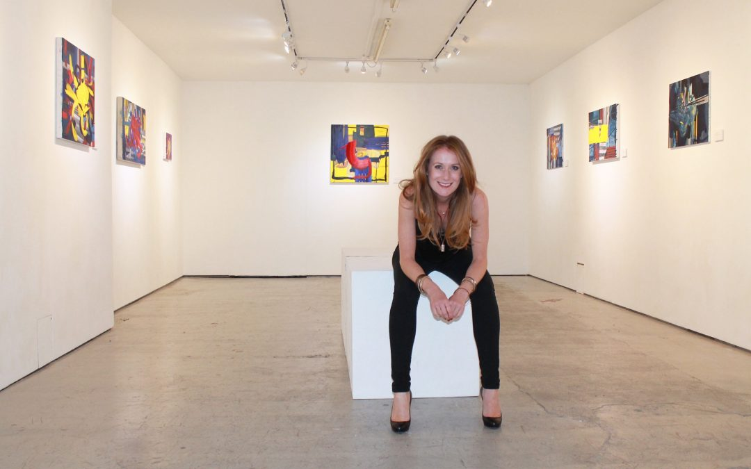 irish contemporary artist sitting with her paintings at a solo exhibition, female painter, abstract painter, female abstract painter, irish abstract art, irish abstract painter, red head, red hair, irish art, irish artist, contemporary painter, contemporary painting, contemporary irish art, modern irish art, modern art uk, contemporary art uk, abstracter uk, abstract painting uk, abstract painting ireland,