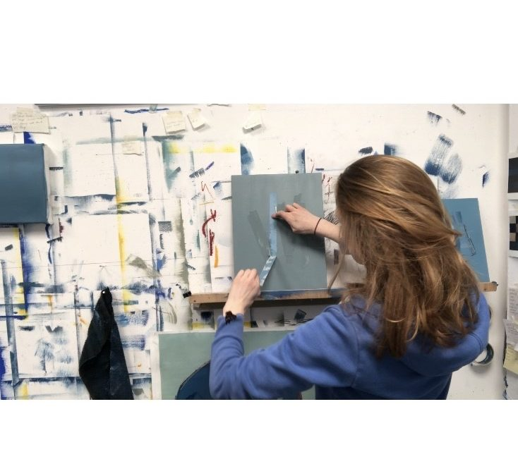 aisling drennan abstract painter pulling masking tape off a painting