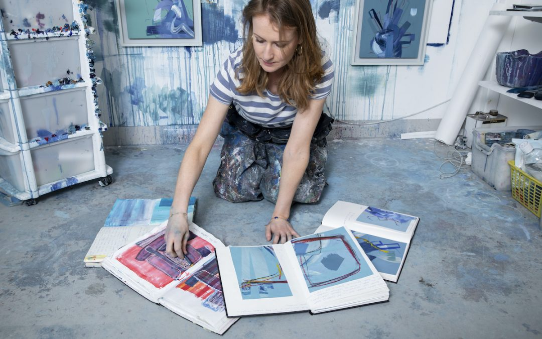 AISLING DRENNAN IN HER ART STUDIO WITH SKETCH BOOKS AND ABSTRACT PAINTINGS. Small and large abstract paintings. painting techniques, abstract painting artists, original art for sale near me, abstract art prints for sale, buy abstract art prints, female abstract artists, abstract art artists, abstract, artists on instagram contemporary, abstract artists uk, irish abstract art, where to buy art online, how to buy direct from an artist, new home artwork, abstract painters, online abstract painter on instagram, art for sale by artist, original art for sale ireland, abstract art prints ireland, art for sale near me, how to buy art for your home, art at home, art for my home, art for your home, where to buy art for your home, colourful abstract art, zoom call backdrop, at home office art